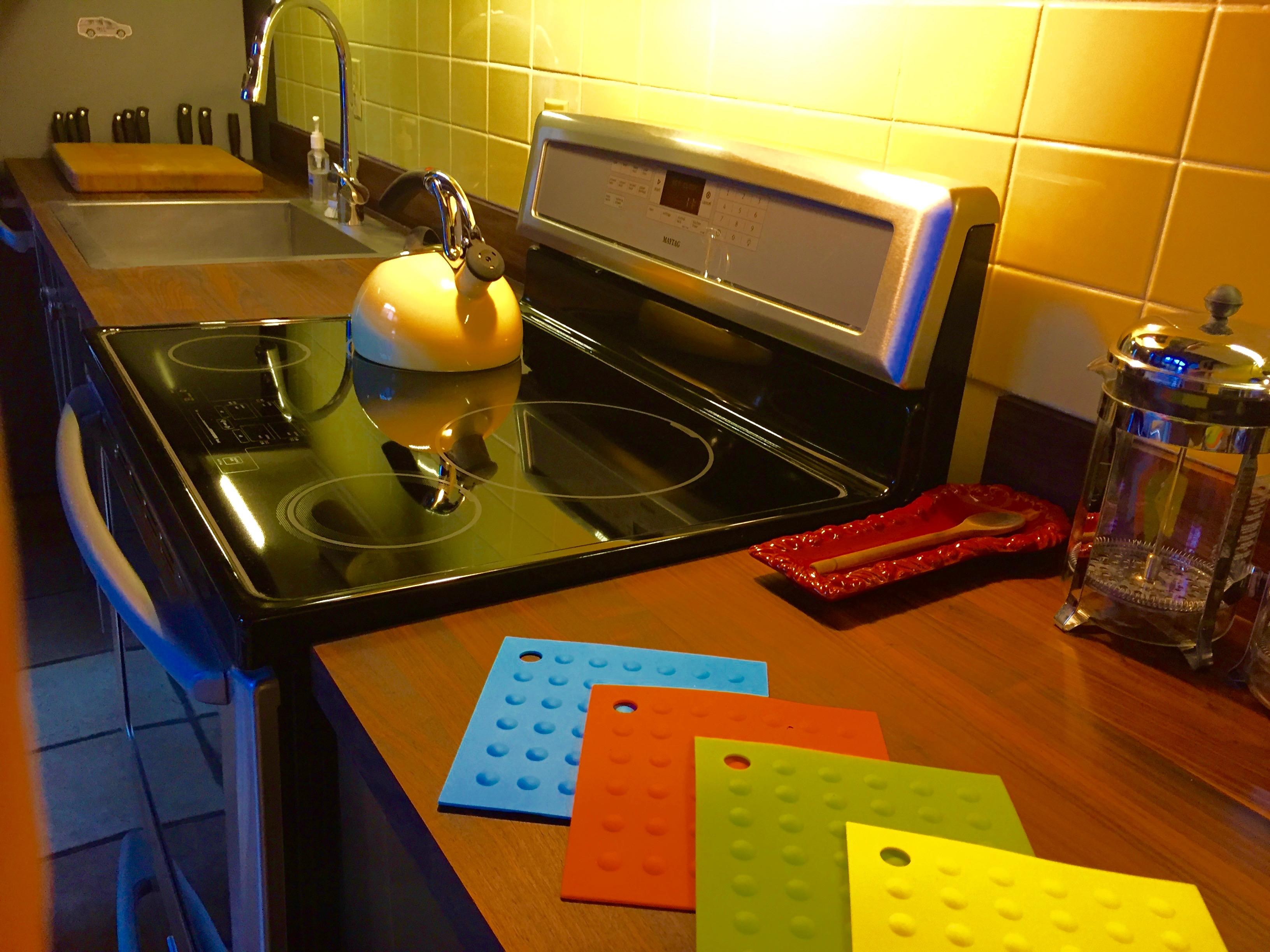 Kitchen, induction stove, walnut countertops
